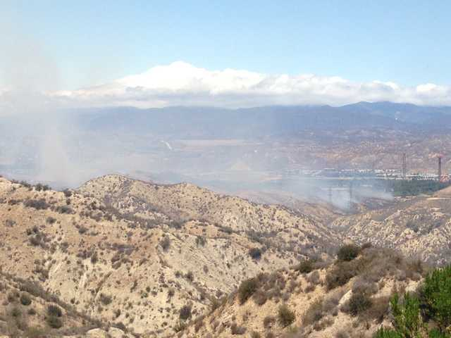 Smoke billows near Six Flags Magic Mountain in the Santa Clarita Valley on Tuesday. Signal photo by Jonathan Pobre.