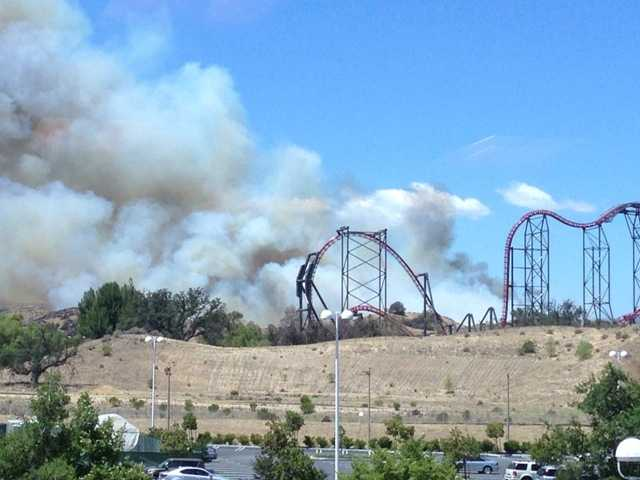 Smoke billows near Six Flags Magic Mountain in the Santa Clarita Valley on Tuesday. Photo courtesy of James Parker.