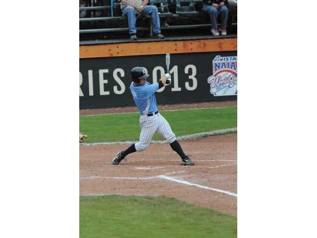 The Master's College's Spencer Toth swings against Lewis-Clark State College during the NAIA World Series in Lewiston, Idaho on Tuesday. TMC lost 3-2. Photo courtesy of Referee Photo.