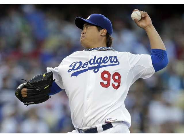 Los Angeles Dodgers starting pitcher Hyun-Jin Ryu throws against the Los Angeles Angels in Los Angeles on Tuesday.
