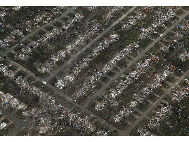 This May 21 photo shows aerial view of an entire neighborhood destroyed by a tornado, in Moore, Okla.