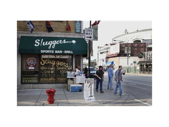 This Sept. 21, 2010 file photo shows Sluggers Sports Bar and Grill near Wrigley Field, before a Chicago Cubs baseball game in Chicago. On Thursday, May 30, 2013, Sami Samir Hassoun, a Lebanese immigrant, is scheduled to be sentenced at federal court in Chicago for placing a backpack he thought held a bomb outside the bar in September 2010.