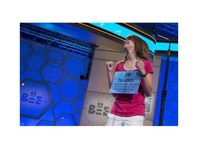 "Isabel Cholbi of San Bernardino, Calif., reacts after spelling the word ""telergy"" correctly during the semifinal round of the National Spelling Bee, today in Oxon Hill, Md."