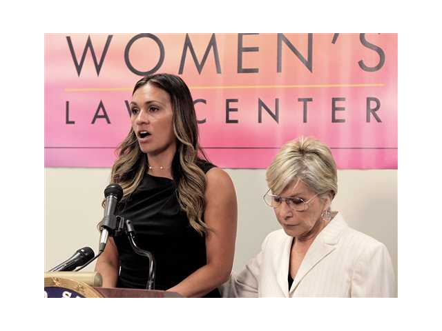 Sen. Barbara Boxer, D-Calif., right joins former U.S. Marine and survivor of military sexual assault Stacey Thompson at a news conference at the California Women's Law Center in Los Angeles today.