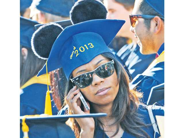 Music and vocal student Chaunte Vigil wears ears on her graduation cap during the 2013 College of the Canyons commencement ceremony held at the Valencia campus Honor Grove on Friday. Signal photo by Dan Watson
