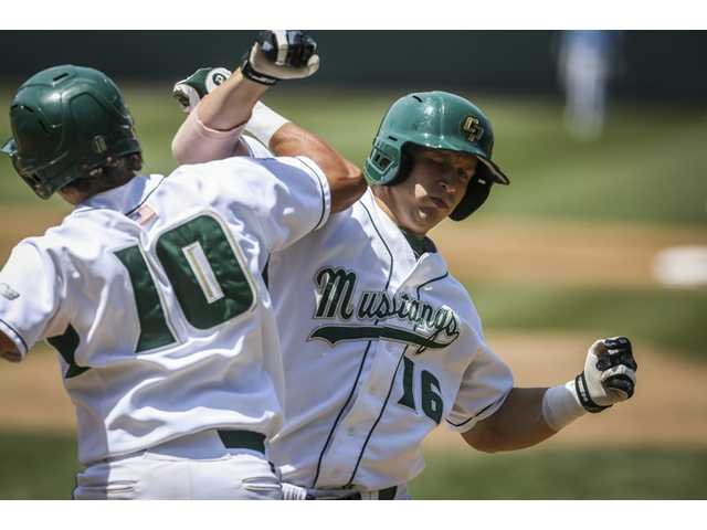 Cal Poly's Brian Mundell celebrates with teammate Nick Torres after hitting a home run against San Diego during the first inning on Friday in Los Angeles.