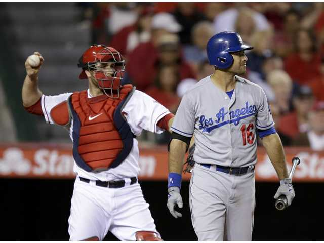 Los Angeles Dodger Andre Ethier, right, reacts after he struck out in Anaheim on Thursday. The Angels won 3-2.
