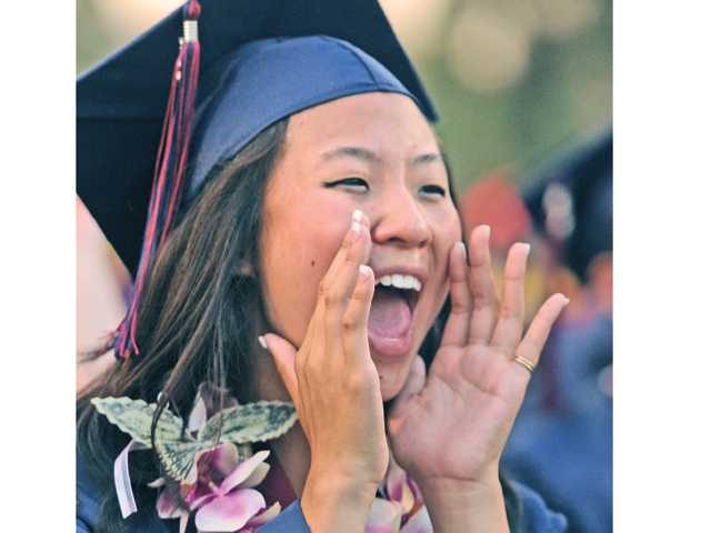 Academy of the Canyons graduating senior Sarah Wong screams as a friend receives her diploma during the commencement ceremony held at College of the Canyons on Friday. Photo by Dan Watson/The Signal