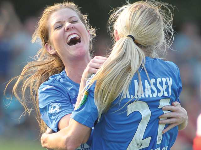 Santa Clarita Blue Heat midfielder Stacey Rodwell, left, celebrates with teammate Kassi Massey after Massey scored a goal against the Los Angeles Strikers on Friday at The Master's College.