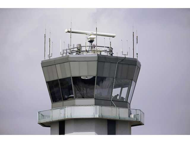 This March 12 file photo shows the air traffic control tower at Chicago's Midway International Airport.