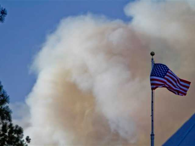 New Mexico fires burning 25 miles from capital