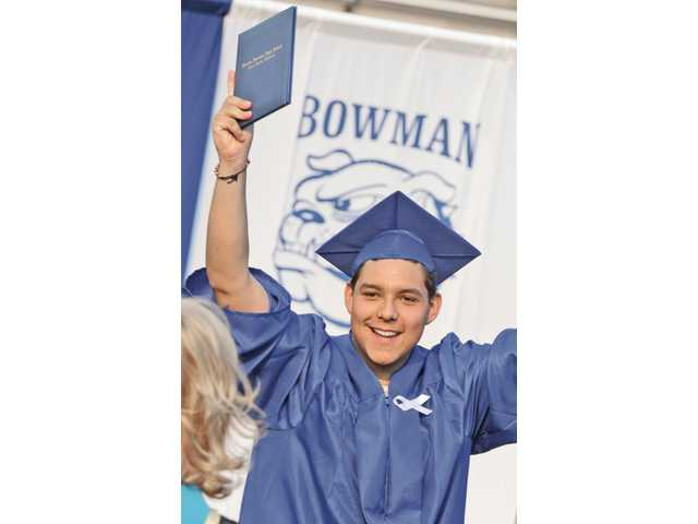 Bowman High School graduate Christopher Gonzalez celebrates after receiving his diploma at the Bowman High commencement ceremony held at College of the Canyons in Valencia on Saturday.
