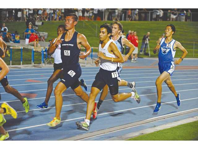 Saugus senior Rodrigo Ornelas, third from right, took 17th in the boys 3,200 race at the CIF State Track and Field Championships on Saturday in Clovis. Photo by Leonard Coutin/For The Signal