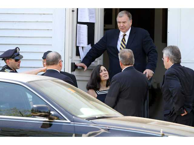 Family and friends leave a memorial service for Nancy Lanza Saturday in Kingston, N.H.