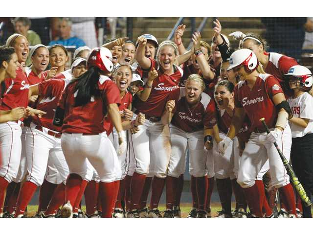 Oklahoma team members celebrate during a Women's College World Series game against Washington in Oklahoma City on Sunday.