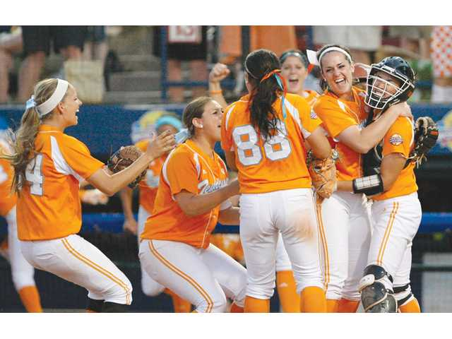 Members of the Tennessee softball team celebrate after defeating Texas in their Women's College World Series game on Sunday in Oklahoma City.