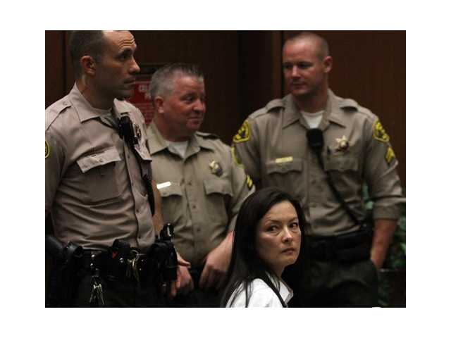 In this Wednesday, May 15, 2013 file photo, Kelly Soo Park looks back at the audience as opening motions are made in her murder trial. Park is charged with the 2008 killing of aspiring model and actress Juliana Redding.