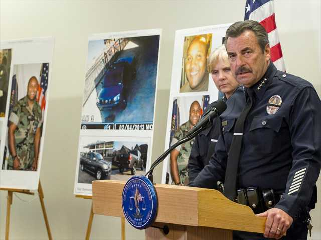 In this Feb. 2013 file photo, Los Angeles Police Chief Charlie Beck, right, comments on fired officer, Christopher Dorner, seen left on police photos, during a news conference at the LAPD headquarters in Los Angeles.