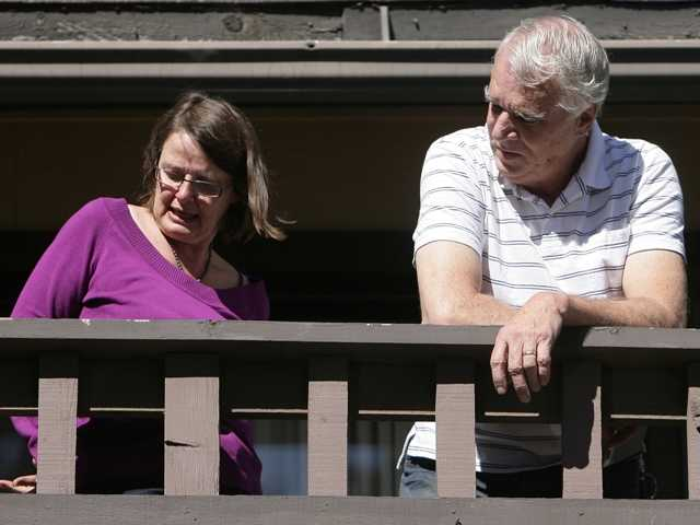 Karen Reynolds and her husband, Jim, right, shows how they were tied up by rogue LAPD officer Christopher Dorner in Big Bear Lake.