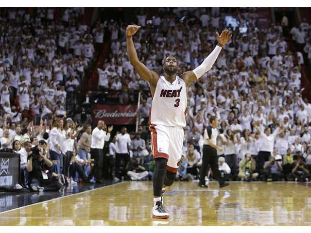 Miami Heat shooting guard Dwyane Wade (3) reacts to play against the Indiana Pacers during the second half of Game 7 Monday in Miami.