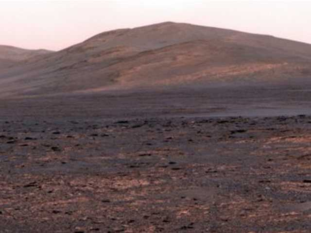 "This image provided by NASA shows a panoramic view from NASA's Mars Exploration rover Opportunity of ""Solander Point."" The space agency said Friday June 7, 2013, the six-wheel, solar-powered rover is driving to a new spot in Endeavour Crater."