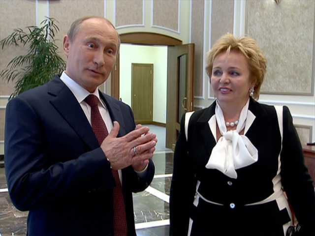 "In this grab made from video provided by the Russia24 TV Channel on Thursday, Russian President Vladimir Putin, left, and his wife Lyudmila speak to journalists after attending the ballet ""La Esmeralda"" in the Kremlin Palace in Moscow, Russia."