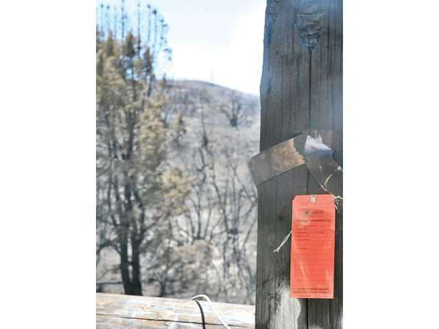 A fire-damaged utility pole on Newview Drive in Lake Hughes as it appeared last Tuesday.