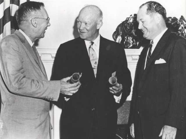 This undated image provided by NASA shows President Dwight Eisenhower, center, commissioning Dr. T. Keith Glennan, right, as the first administrator for NASA and Dr. Hugh L. Dryden as deputy administrator, in Washington, D.C. A bill in Congress wants to rename the NASA Dryden Flight Research Center in Southern California after Neil Armstrong.