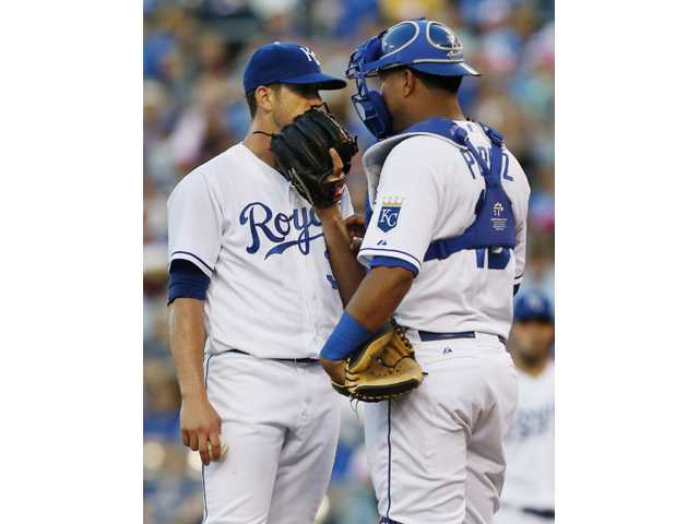 Kansas City Royals starting pitcher James Shields, left, talks with catcher Salvador Perez against the Houston Astros at Kauffman Stadium in Kansas City, Mo., on Friday.