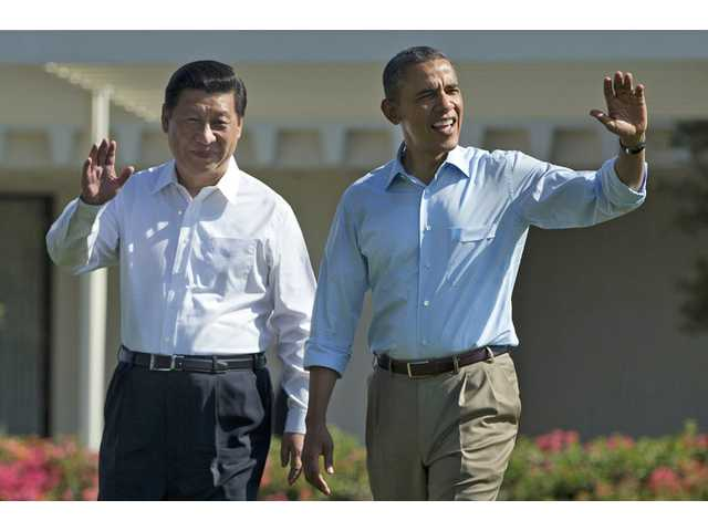 President Barack Obama and Chinese President Xi Jinping walk at the Annenberg Retreat of the Sunnylands estate Saturday in Rancho Mirage, Calif.