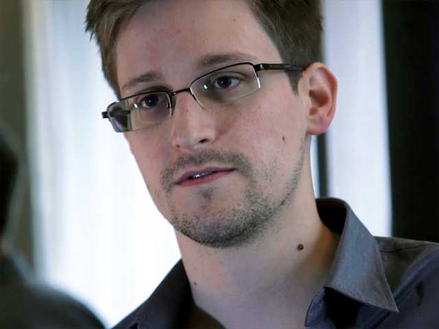 This photo provided by The Guardian Newspaper in London shows Edward Snowden, who worked as a contract employee at the National Security Agency, on Sunday, in Hong Kong. The Guardian identified Snowden as a source for its reports on intelligence programs after he asked the newspaper to do so on Sunday.