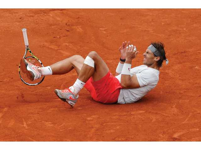 Spain's Rafael Nadal celebrates winning against compatriot David Ferrer in three sets 6-3, 6-2, 6-3, in the final of the French Open, at Roland Garros stadium in Paris on Sunday.