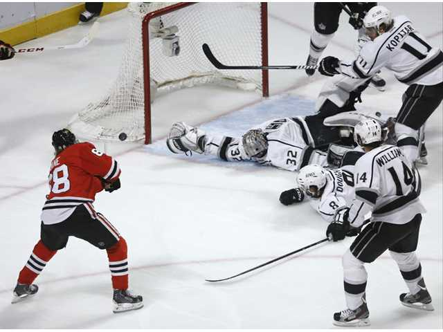 Chicago Blackhawks right wing Patrick Kane (88) scores a goal against the Los Angeles Kings on Saturday in Chicago.