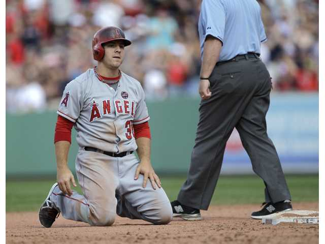 Los Angeles Angels player J.B. Shuck (39) reacts after getting caught out in a rundown between second and third against the Boston Red Sox on Sunday in Boston.