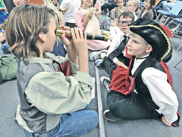 "Evan Shumaker, left, and Lucas Robinson, dressed in the costumes of historical figures, look through a spyglass during the ""Gold Rush Days"" history event at Meadows Elementary School in Valencia. Signal photo by Dan Watson"