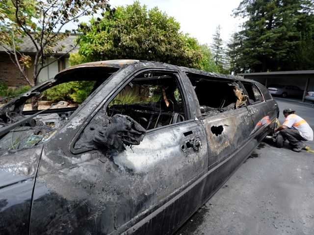 The burned out 2009 Lincoln Town Car limousine where ten elderly women escaped when the limousine burst into flames. (AP Photo/The Contra Costa Times-Bay Area News Group, Susan Tripp Pollard)
