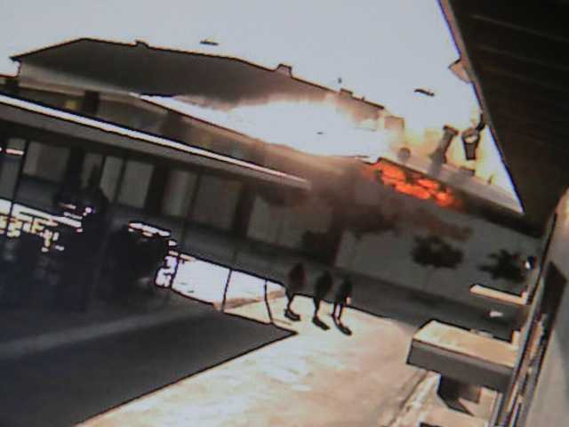 In this still image taken from a security camera show students at Santa Ana High School reacting during a explosion in the boiler room Tuesday.