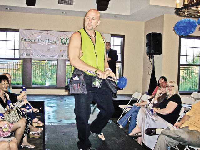 Plumber Kirk Stinson entertained guests at the second annual Gentlemen for a Cause to benefit Bridge to Home.