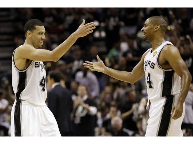 San Antonio Spur Danny Green, left, reacts with Gary Neal after scoring against the Miami Heat on Tuesday in San Antonio.