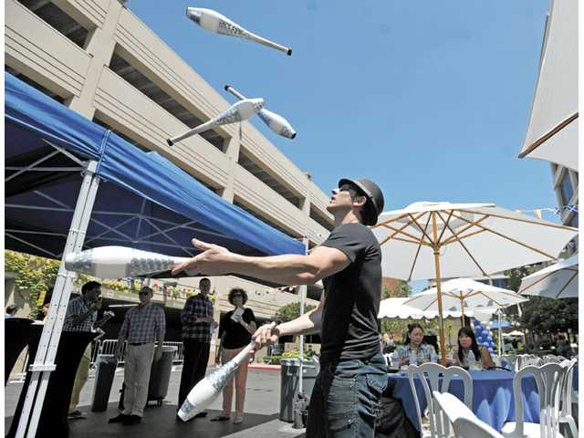 Guest entertainer Chuck Gunter juggles for the crowd at Princess Cruises' shoreside celebration for the Royal Princess outside the cruise line's headquarters in Valencia. Jonathan Pobre/The Signal