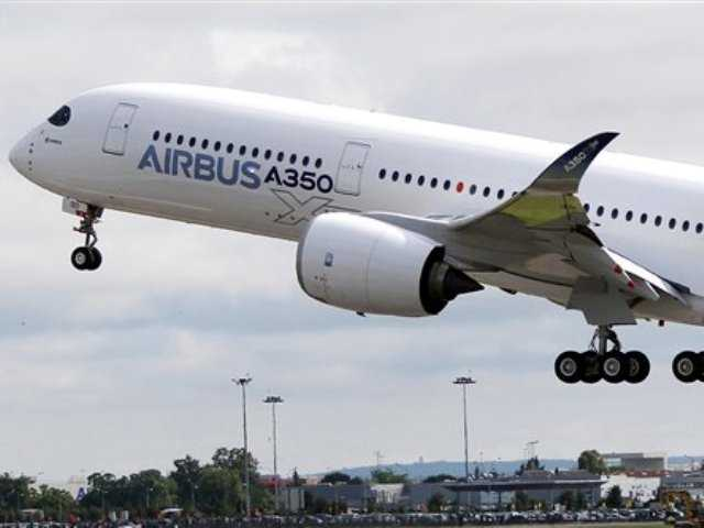 The Airbus A350 takes off on its maiden flight at Blagnac airport near Toulouse, southwestern France today.