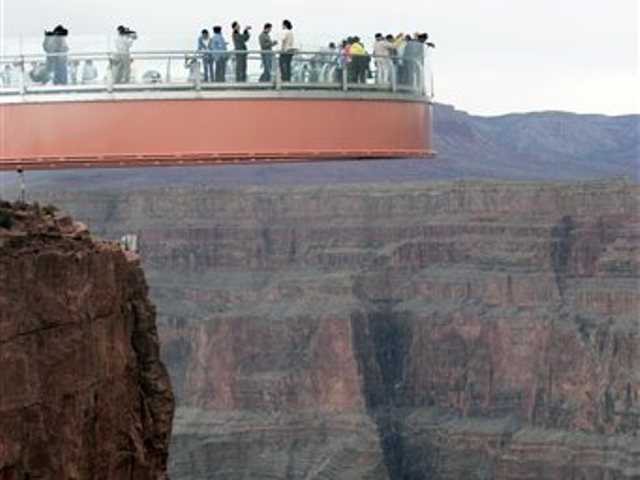 This March 20, 2007 file photo shows people walking on the Skywalk during the First Walk event at the Grand Canyon on the Hualapai Indian Reservation at Grand Canyon West, Ariz. David Jin the Chinese tour operator and Las Vegas businessman and who built this Grand Canyon Skywalk attraction in northwestern Arizona has died in Los Angeles.