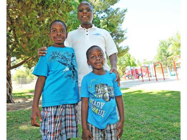 Kunle Olofinboba poses with his sons Kanmi, 9, left, and Tomi, 5, at Santa Clarita Park in Saugus on Friday. Olofinboba says he spends more time with his kids than his father did with him. Signal photo by Jonathan Pobre