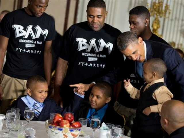 President Barack Obama greets guests, including fathers and their children participants in the Becoming a Man (BAM) program at Hyde Park Academy in Chicago, Friday in the State Dining Room of the White House in Washington, where the president hosted a Father's Day luncheon.