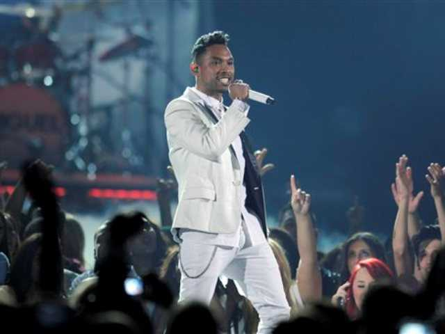 In this May 19, 2013 file photo, Miguel performs at the Billboard Music Awards at the MGM Grand Garden Arena, in Las Vegas.