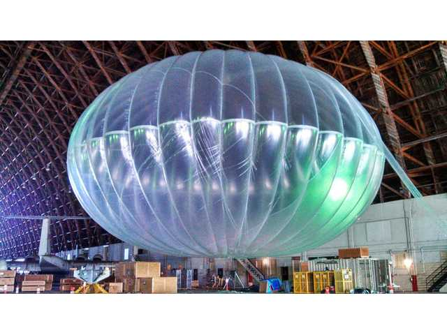 A fully inflated test balloon sits in a hangar. Google is testing the balloons which sail in the stratosphere and beam the Internet to Earth.