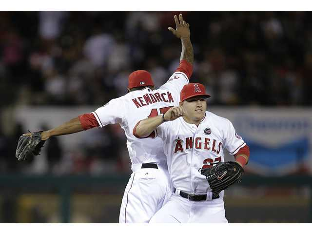 Los Angeles Angels' Mike Trout, right, and Howie Kendrick celebrate their team's 5-2 win against the New York Yankees on Friday in Anaheim.