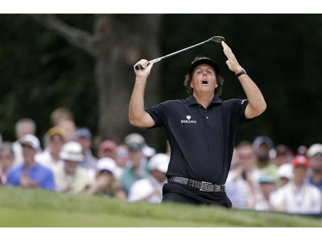 Phil Mickelson reacts to his shot during the final round of the U.S. Open at Merion Golf Club on Sunday in Ardmore, Pa.