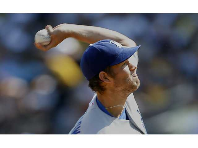 Los Angeles Dodgers starting pitcher Clayton Kershaw throws against the Pittsburgh Pirates in the first inning Saturday in Pittsburgh.