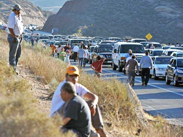 Motorists wait for freeway lanes to clear following a multi-car pileup on northbound Highway 14 south of Escondido Canyon Road in Agua Dulce on Monday. Photo by Jonathan Pobre.